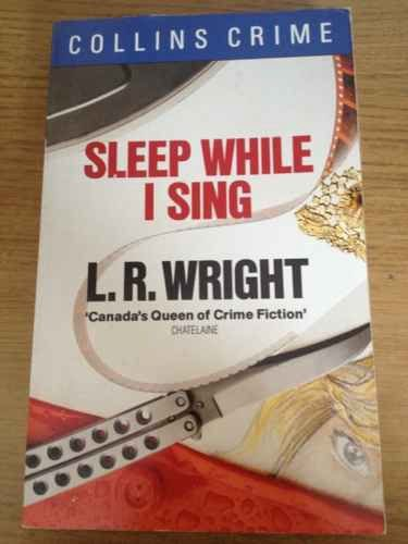 Sleep While I Sing By L.R. Wright